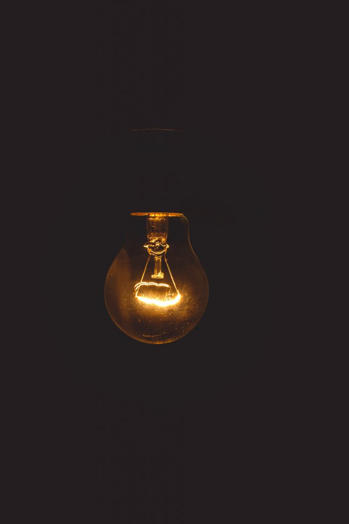 electric bulb lit with amber lights