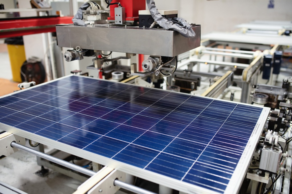 solar panel being manufactured