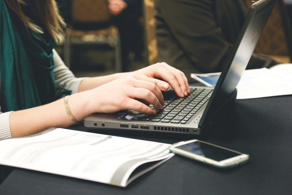 caucasian hands on a laptop keyboard