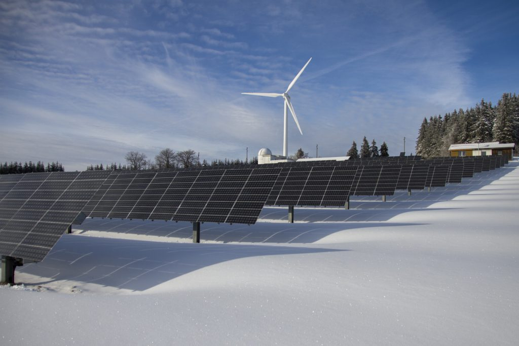 solar panels with snow on the ground