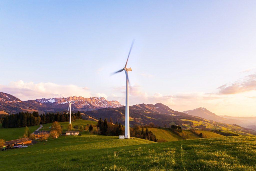 wind turbine in a field near a house
