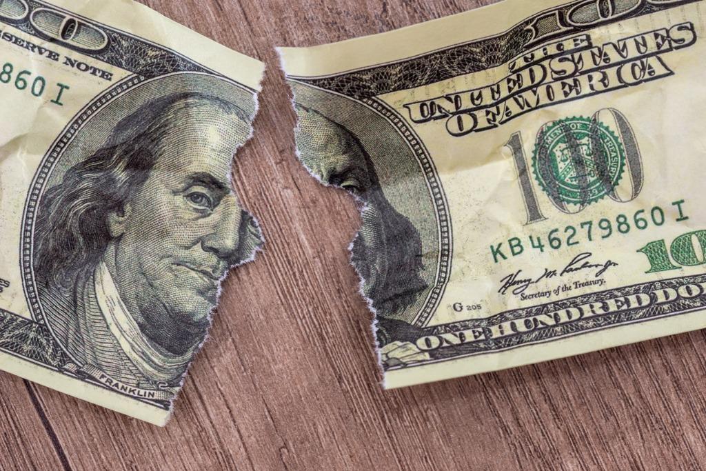 hundred dollar bill ripped in half