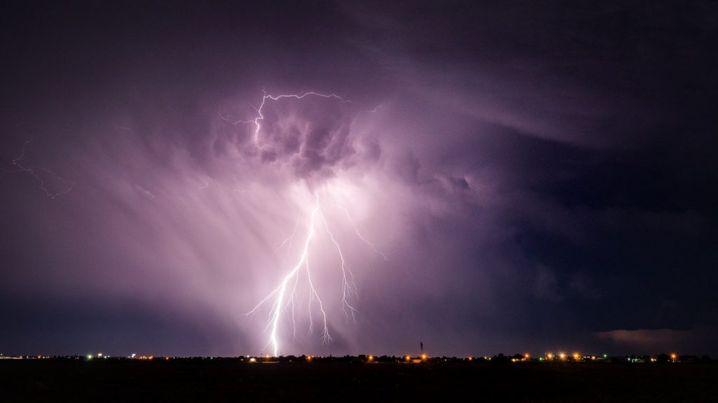 lightning in the sky above a city