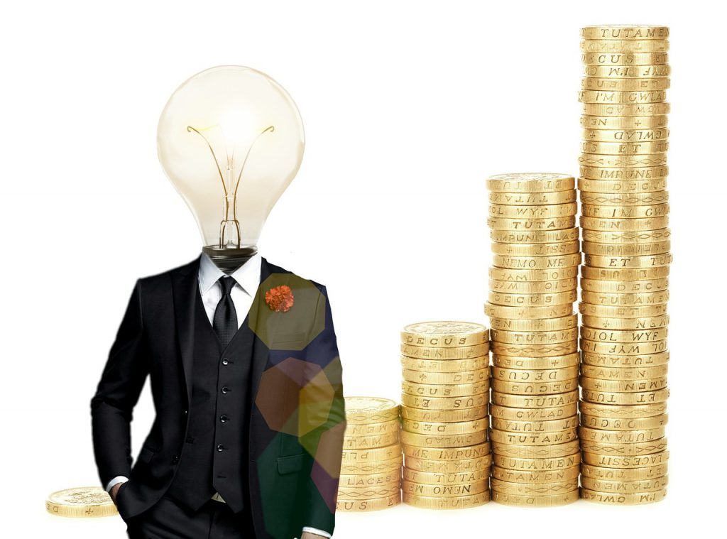 business suit with a light bulb as a head with coins stacked next to it